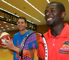 John Isner and James Ennis. 2013. GETTY IMAGES