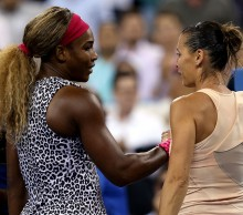 Serena Williams (L) shakes hands with Flavia Pennetta after winning their US Open 2014 quarterfinal battle; Getty Images
