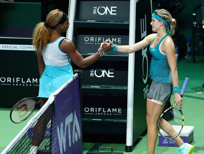 Serena Williams (L) shakes hands with Eugenie Bouchard after winning their round robin match at the WTA Finals in Singapore; Getty Images