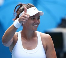 Casey Dellacqua celebrates following her third-round victory at Australian Open 2014; Getty Images