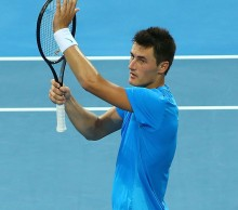 Bernard Tomic celebrates his victory over Novak Djokovic at Hopman Cup 2013; Getty Images