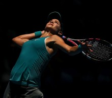 Eugenie Bouchard serves out of the shadows; Getty Images