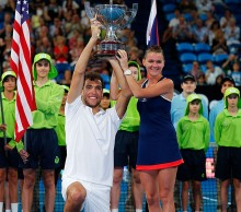 The long and the short of the trophy presentation; Getty Images