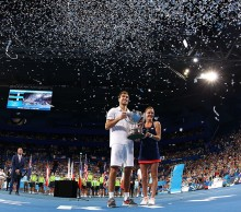 Jerzy Janowicz and Agnieszka Radwanska celebrate Poland's first-ever Hopman Cup title; Getty Images