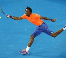 Gael Monfils of France stretches to play a forehand in his first round match against  Lucas Pouille of France during day two of the 2015 Australian Open at Melbourne Park on January 20, 2015 in Melbourne, Australia.  (Photo by Mark Kolbe/Getty Images)