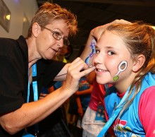 Face painting is part of the fun.