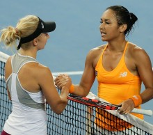 Heather Watson of Great Britain hugs Daria Gavrilova of Australia Green