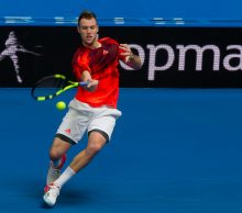 Jack Sock of the US hits a return against Alexandr Dolgopolov of Ukraine during their third session men's singles match on day two of the Hopman Cup tennis tournament in Perth on January 4, 2016.     AFP PHOTO / Tony ASHBY   -IMAGE RESTRICTED TO EDITORIAL USE - NO COMMERCIAL USE / AFP / TONY ASHBY        (Photo credit should read TONY ASHBY/AFP/Getty Images)