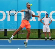 Roger Federer practices at Mastercard Hopman Cup; Getty ImagesRoger Federer practices at Mastercard Hopman Cup; Getty Images