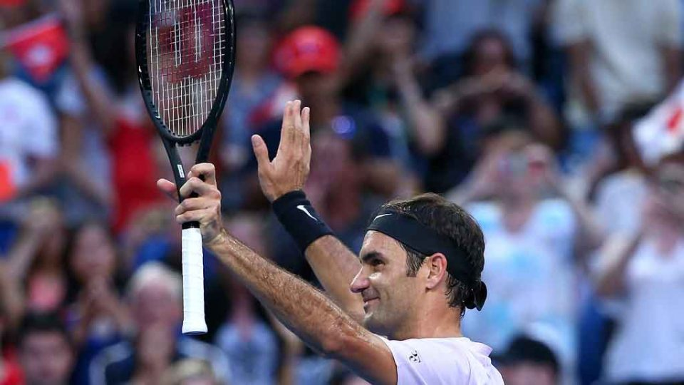 Roger Federer salutes the Mastercard Hopman Cup crowd after victory over Sugita: Getty