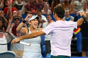 Belinda Bencic and Roger Federer celebrate their team title; Getty Images