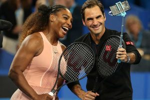 Serena Williams and Roger Federer finish a special match with a selfie.