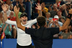 Bencic and Federer celebrate their victory.